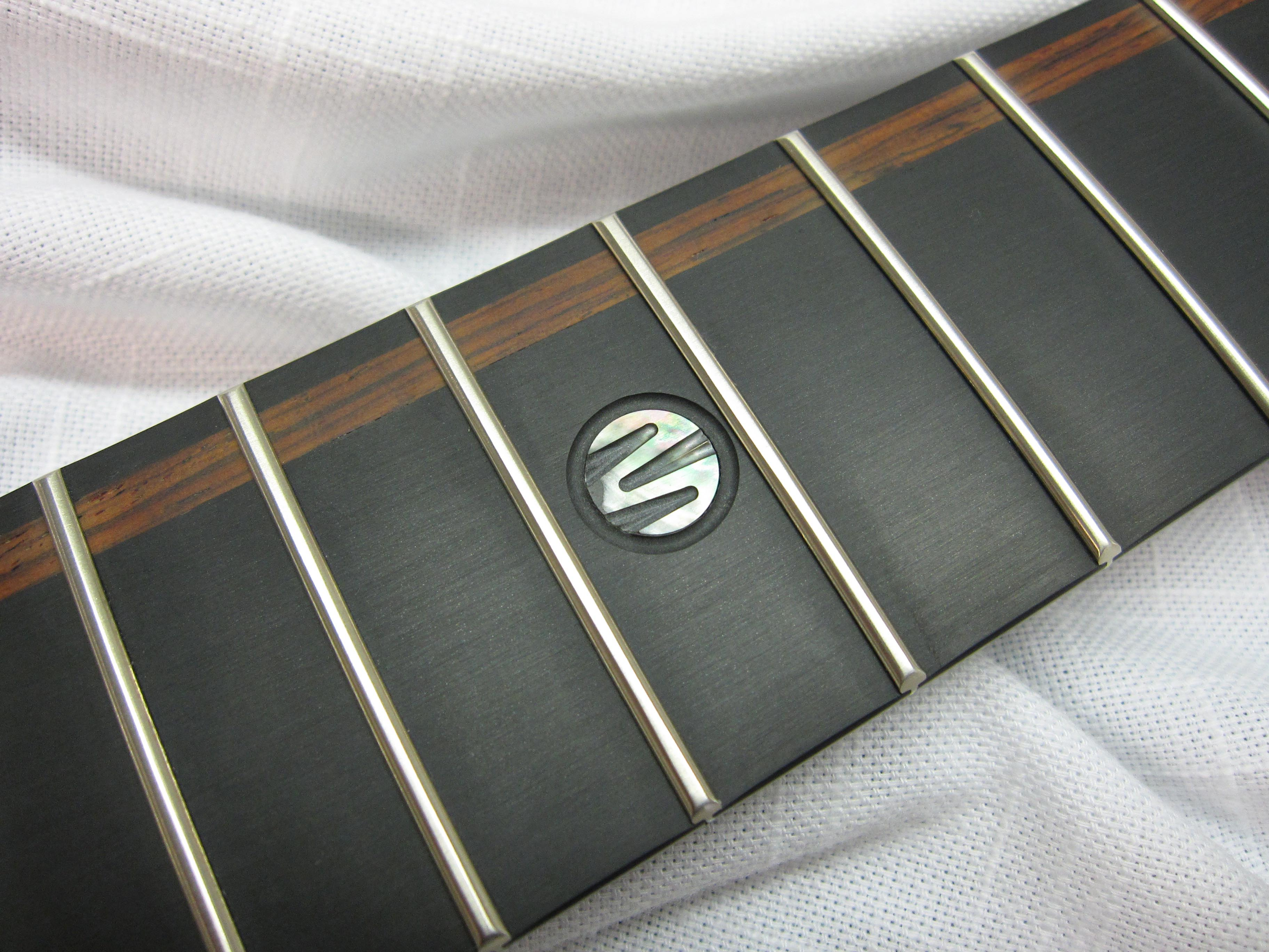 Black Pearl Moses 'M' inlay with wood detail at 12th fret