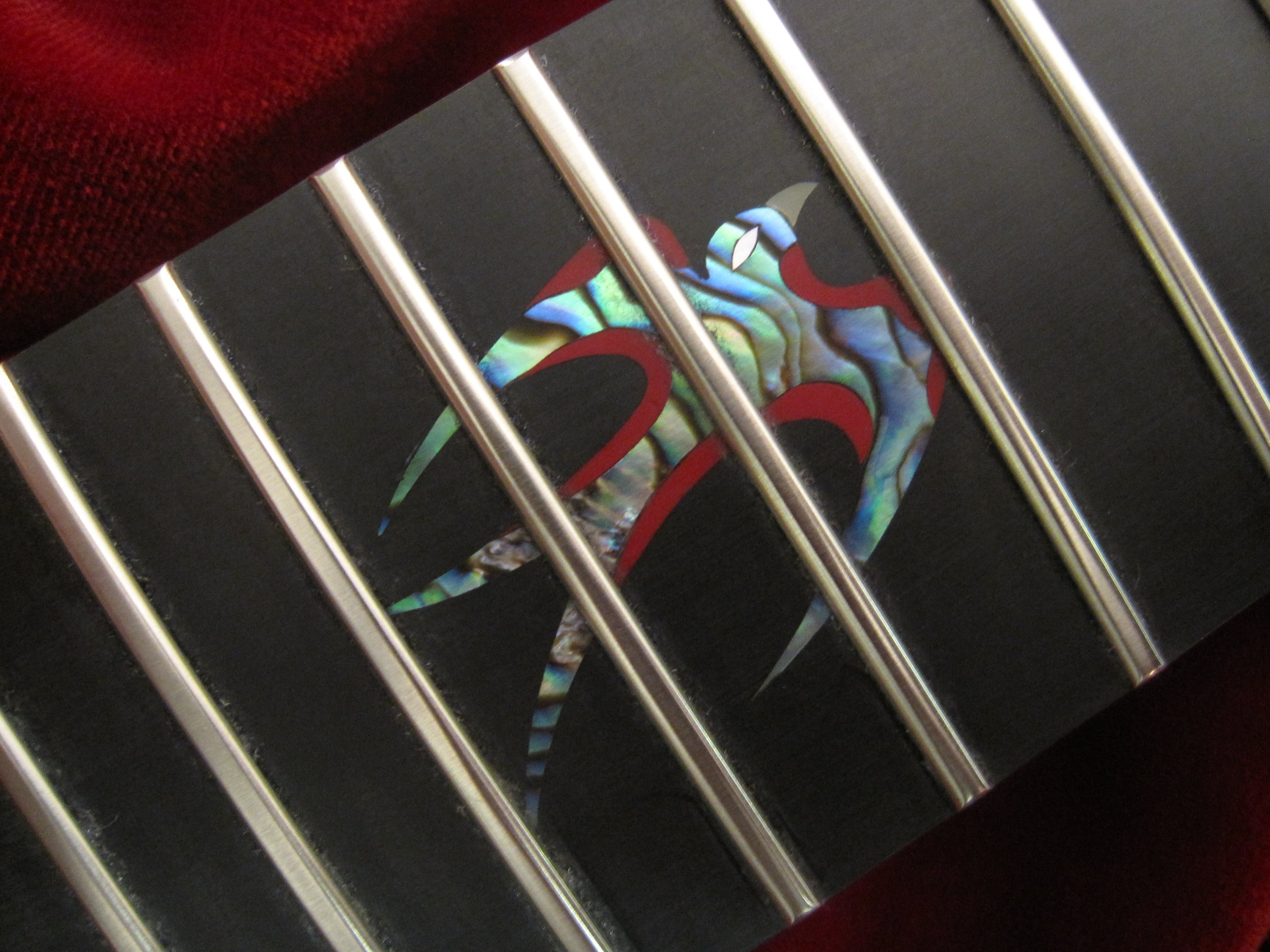 Custom shell bird inlay